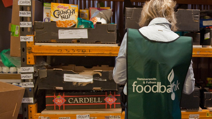 A volunteers sorts through donations of food at the Hammersmith and Fulham food bank run by the Trussell Trust in London (AFP Photo/Will Oliver)
