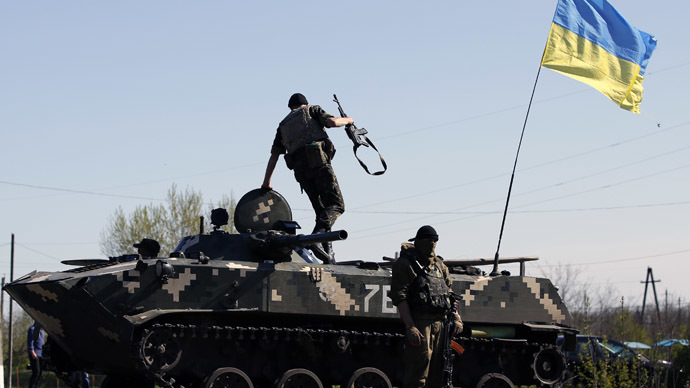A Ukrainian soldier jumps off an armoured personnel carrier at a checkpoint in the village of Malinivka, east of Slaviansk in eastern Ukraine April 24, 2014. (Reuters)