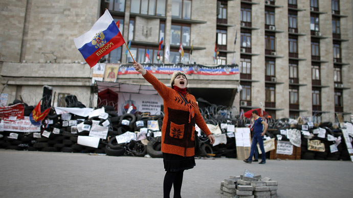 A pro-federalization protester shout slogans as she waves a Russian flag outside a regional government building in Donetsk, in eastern Ukraine April 23, 2014. (Reuters)