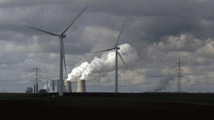 Wind turbines are seen in front of a coal power plant of German utility RWE Power near the western town of Neurath (Reuters)