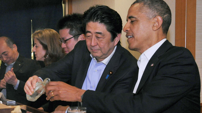 Japanese Prime Minister Shinzo Abe (2nd R) pours sake for U.S. President Barack Obama (R) as they have dinner at the Sukiyabashi Jiro sushi restaurant in Tokyo, in this picture taken April 23, 2014, and released by Japan's Cabinet Public Relations Office. (Reuters)