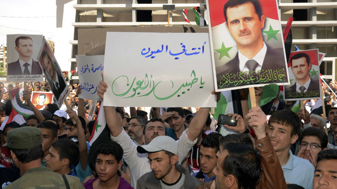 Supporters of Syria's President Bashar al-Assad take part in a rally showing support a day after he declared that he would seek re-election in June, in Aleppo April 29, 2014. (Reuters)