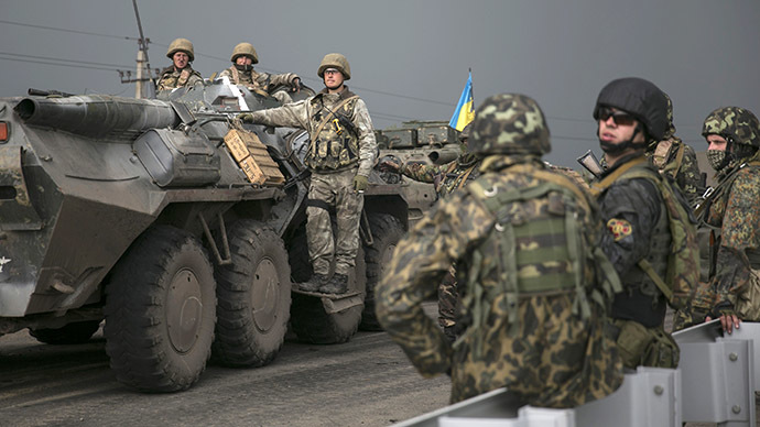 Ukrainian soldiers stand near an armored personnel carrier at a checkpoint near the town of Slavyansk in eastern Ukraine May 2, 2014. (Reuters / Baz Ratner)
