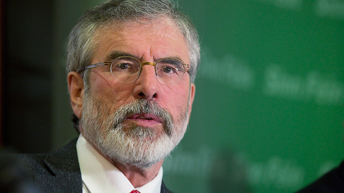 Sinn Fein President Gerry Adams holds a news conference after he was released from police detention, in Belfast, May 4, 2014 (Reuters / Paul Hackett)