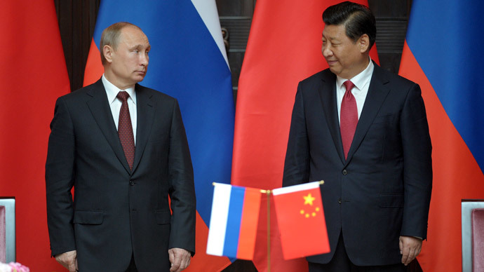 Russia's President Vladimir Putin (L) and China's President Xi Jinping attend an agreement signing ceremony during a bilateral meeting at Xijiao State Guest house ahead of the fourth Conference on Interaction and Confidence Building Measures in Asia (CICA) summit, in Shanghai on May 20, 2014.(AFP Photo /  Alexey Druzhinin)