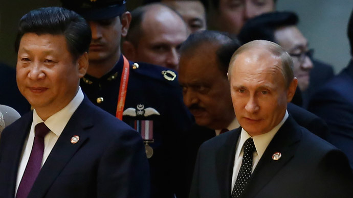 ussian President Vladimir Putin (R) and Chinese President Xi Jinping attend a gala dinner ahead of the fourth Conference on Interaction and Confidence Building Measures in Asia (CICA) summit, in Shanghai May 20, 2014.(Reuters / Aly Song)