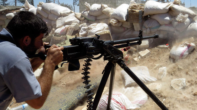 A Free Syrian Army fighter fires his weapon towards forces loyal to Syria's President Bashar al-Assad in Mork, northern Hama countryside May 18, 2014.(Reuters / Stringer)