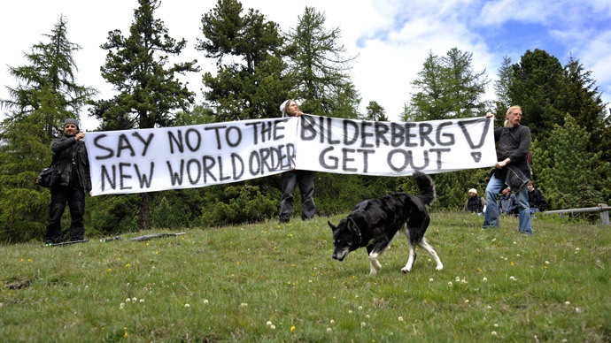 ARCHIVE PHOTO: Activists protest on June 9, 2011 in front of the Suvretta House five-star hotel in the chic Swiss ski station of St Moritz, where the Bilderberg Group is holding its annual meeting. (AFP Photo / Fabrice Coffrini)