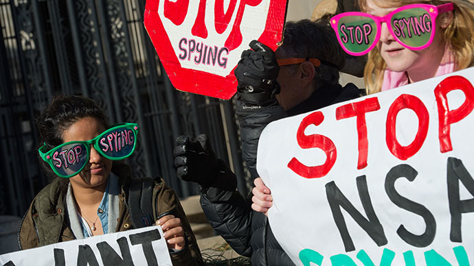 Civil liberties activists hold a rally against surveillance of US citizens as US President Barack Obama is expected to announce reforms of the National Security Agency (NSA) at the Justice Department in Washington on January 17, 2014 (AFP Photo / Nicholas Kamm)