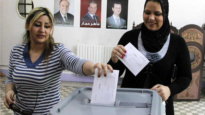 Women cast their votes in the presidential election at a polling centre in Damascus June 3, 2014. (Reuters)