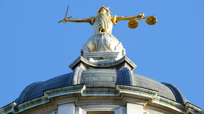 The statue of justice stands on the copula of the Old Bailey courthouse (AFP Photo)