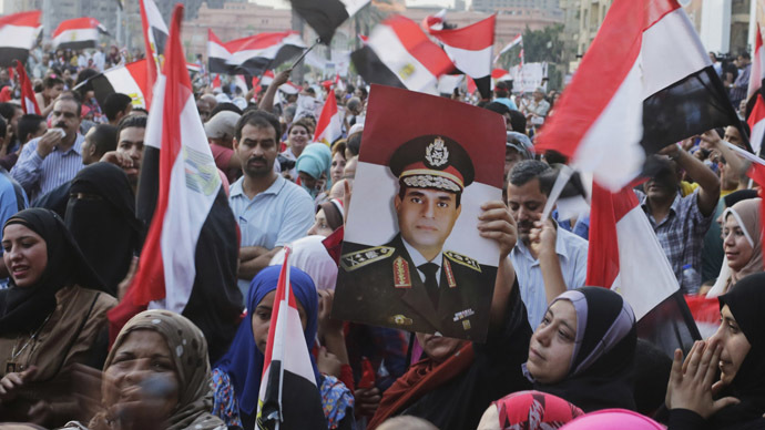 Egyptians chant slogans in Tahrir square as they arrive to celebrate former Egyptian army chief Abdel Fattah al-Sisi's victory in the presidential vote in Cairo, June 3, 2014. (Reuters/Asmaa Waguih)