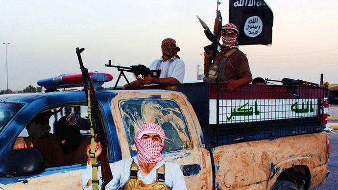 An image uploaded on June 14, 2014 on the jihadist website Welayat Salahuddin allegedly shows militants of the Islamic State of Iraq and the Levant (ISIL) riding in a captured vehicle left behind by Iraqi security forces at an unknown location in the Salaheddin province. (AFP Photo)
