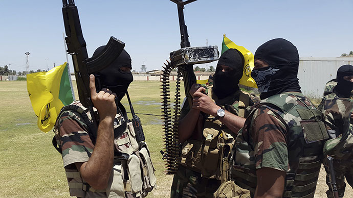 Shi'ite fighters take part in an intensive security deployment with the Iraqi army in Diyala province, 40 km (25 miles) north of Baghdad, June 16, 2014. (Reuters)