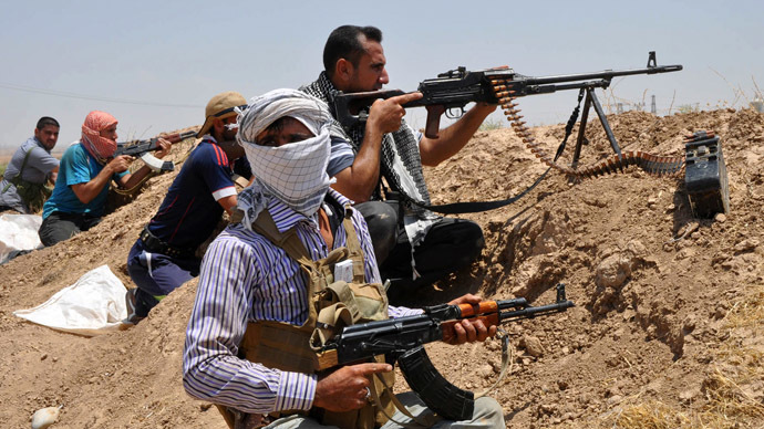 Iraqi Shi'ite Turkmen fighters take part in an intensive security deployment in the town of Taza, south of the northern oil city of Kirkuk, June 19, 2014. (Reuters)