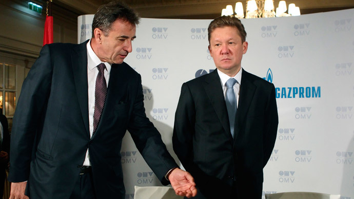 OMV CEO Gerhard Roiss (L) and Gazprom CEO Alexei Miller prepare for a news conference after signing the final deal to build a branch of the South Stream gas pipeline ending in Austria, in Vienna June 24, 2014. (Reuters / Heinz-Peter Bader)