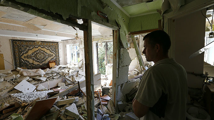 A local resident stands inside an apartment inside a block of flats damaged by a recent shelling in the eastern Ukrainian town of Kramatorsk July 1, 2014. (Reuters / Shamil Zhumatov)
