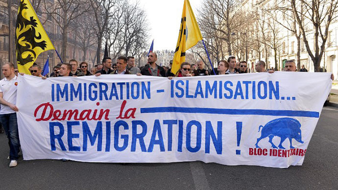 Some two hundreds people demonstrate in the streets of Paris against the government immigration policy on March 9, 2014 in Paris. (AFP Photo / Miguel Medina)