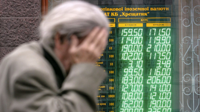 A man walks past a currency exchange office in Kiev (Reuters)