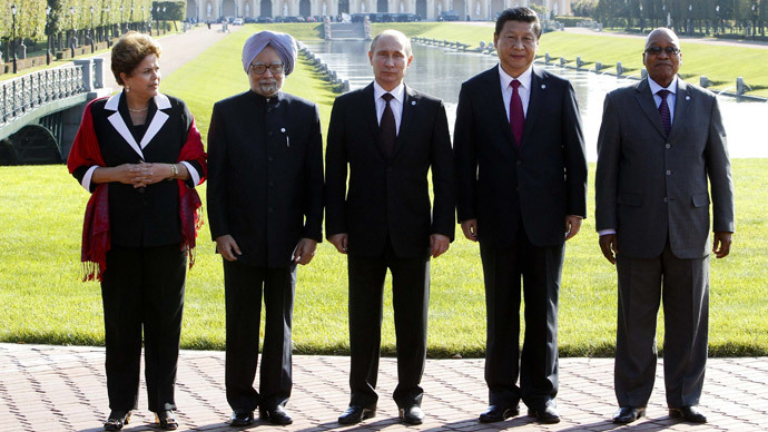 Brazil's President Dilma Rousseff, India's Prime Minister Manmohan Singh, Russia's President Vladimir Putin, China's President Xi Jinping and South African President Jacob Zuma pose for a photo after the BRICS leader's meeting at the G20 summit on September 5, 2013 in Saint Petersburg.(AFP Photo / SergeI Karpukhin)