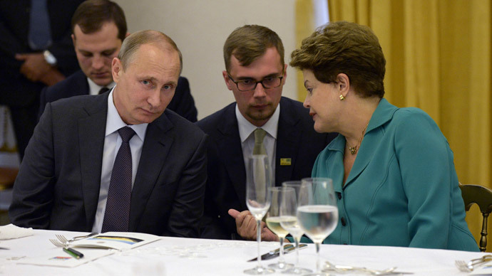 Russia's President Vladimir Putin (L) listens to Brazil's President Dilma Rousseff during a meeting in Rio de Janeiro July 13, 2014.(Reuters / Alexey Nikolsky)