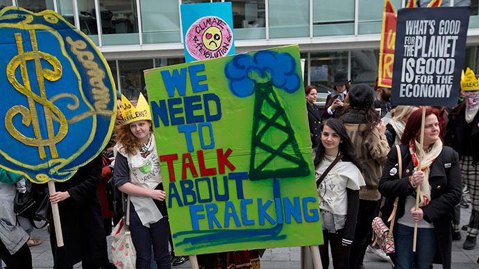 Demonstrators hold banners during an anti-fracking protest in central London March 19, 2014 (Reuters / Neil Hall)