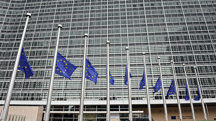 EU Flags fly at half mast in front of the Berlaymont European Commision Bulding in Brussels (AFP Photo)