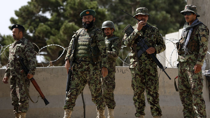 Afghan National Army (ANA) soldiers keep watch at the gate of a British-run military training academy Camp Qargha, in Kabul August 5, 2014. (Reuters)