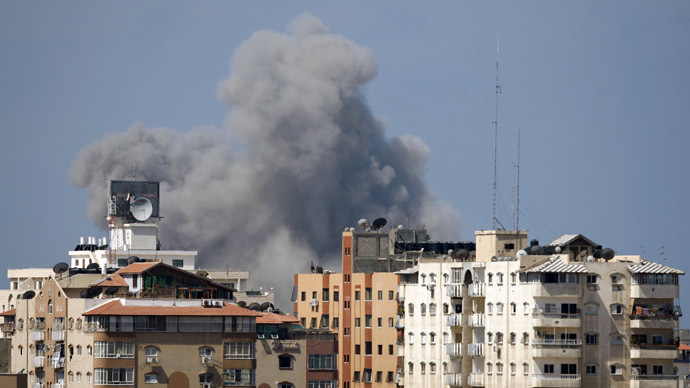 Smoke rises following what witnesses said was an Israeli air strike in Gaza City August 8, 2014. (Reuters)