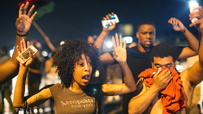 Demonstrators protesting the killing of teenager Michael Brown by a Ferguson police officer try to stand their ground despite being overcome by tear gas on August 17, 2014 in Ferguson, Missouri. (AFP Photo / Getty Images / Scott Olson)