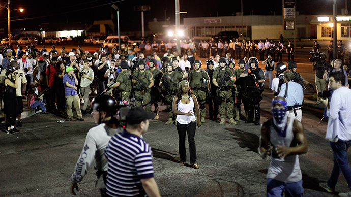 Demonstrators protesting against the shooting of Michael Brown are surrounded by police in riot gear in Ferguson, Missouri August 19, 2014 (Reuters / Joshua Lott)