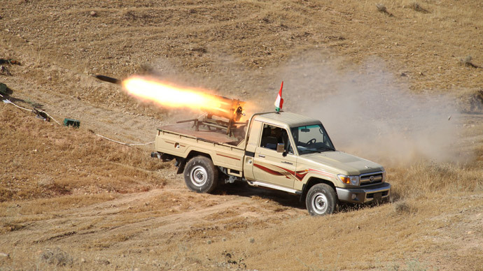 A vehicle belonging to Kurdish security forces fires a multiple rocket launcher during clashes with Sunni militant group Islamic State of Iraq and the Levant (ISIL) on the outskirts of Diyala.(Reuters / Yahya Ahmad)