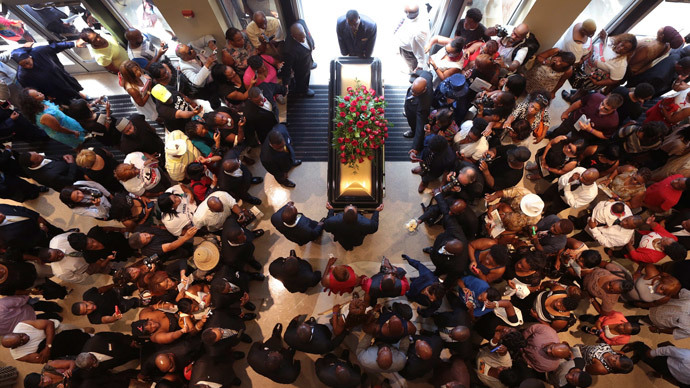 The casket of Michael Brown exits Friendly Temple Missionary Baptist Church at the end of his funeral in St. Louis, Missouri August 25, 2014.(Reuters / Robert Cohen)