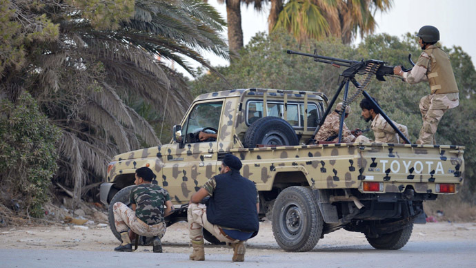 rregular forces loyal to former army general Khalifa Haftar stand by an armed vehicle during clashes with Islamist militants in the eastern city of Benghazi June 2, 2014. (Reuters)
