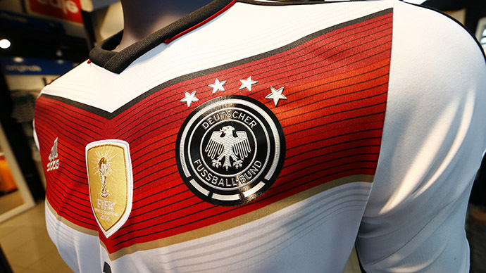 A memorabilia jersey of German national soccer team showing four stars, symbolizing the number of reached World Cup championships, is seen at an Adidas retailer in Frankfurt July 14, 2014. (Reuters / Ralph Orlowski)
