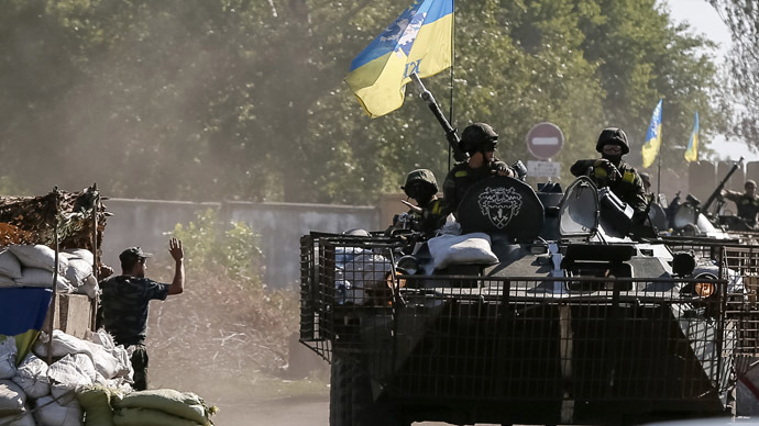 Ukrainian servicemen ride in an armoured vehicle near Kramatorsk September 2, 2014. (Reuters)