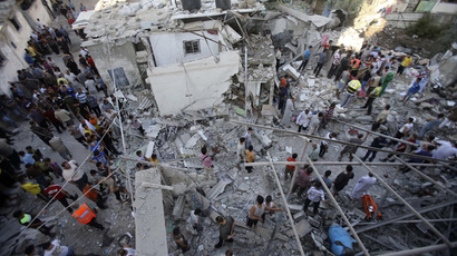 Palestinian rescue workers and onlookers stand on the rubble of a house, which witnesses said was destroyed by an Israeli air strike, as they search for casualties in Rafah, southern Gaza in this August 3, 2014. (Reuters/Ibraheem Abu Mustafa)
