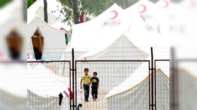 Los niños, proveedores de subsistencia en el éxodo sirio en la frontera turca