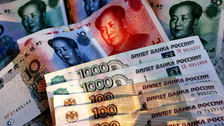 Rusia y China expulsan al dólardel comercio global