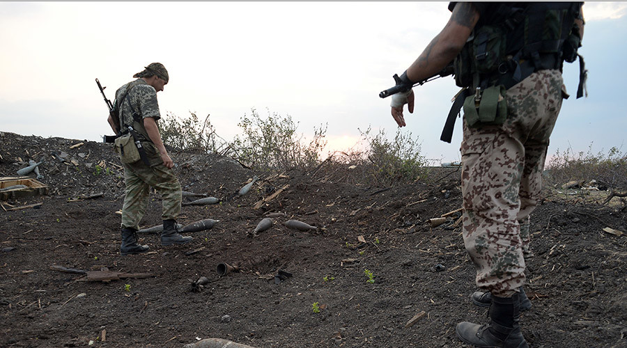 E. Ukraine rebels withdraw lighter weapons from front line