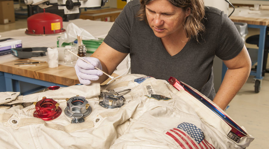 Lisa Young, objects conservator at the Museum, works on Neil Armstrong's Apollo 11 spacesuit.
