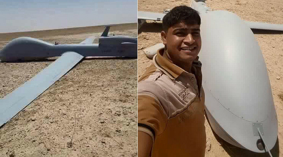 US drone crashes in Iraq desert, locals pose for selfies (PHOTOS, VIDEO)