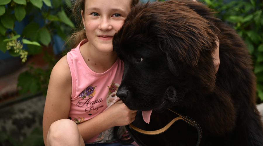 Putin makes Kyrgyz girl's wish come true, gives rare dog as gift