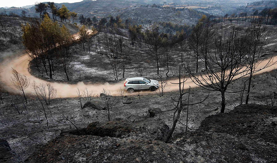 Spanish firefighters go on strike as flames sweep Catalonian forests