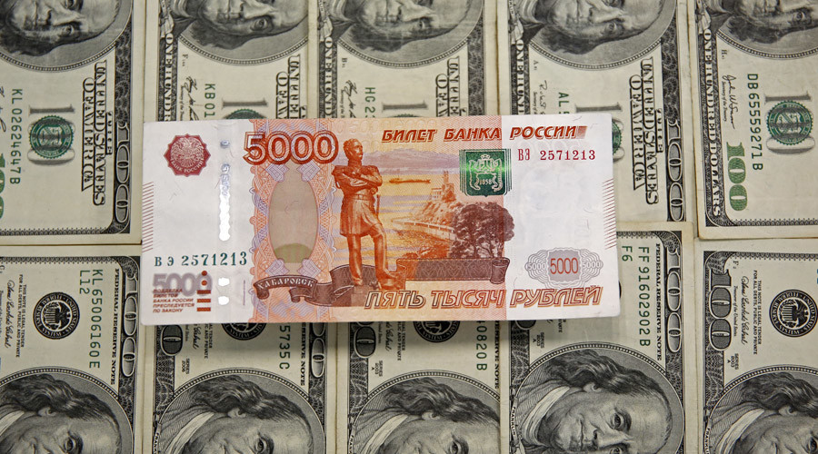 Russian ruble hits 60 against US dollar, close to erasing 2015 gains