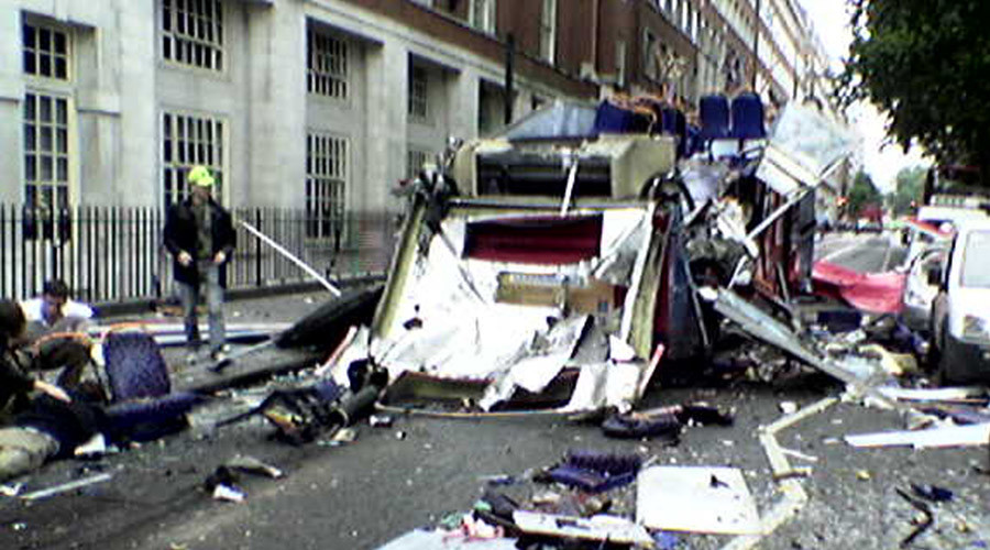 A photograph taken by a passer-by shows victims being helped near Tavistock Place in London following a bomb blast on a bus July 7, 2005. © Ivan Peredruk