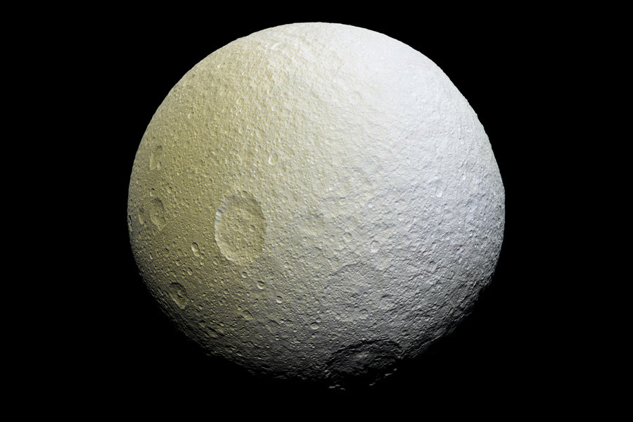 This enhanced-color mosaic of Tethys shows terrain slightly farther to the southwest than images taken a couple of hours earlier. © JPL-Caltech / Space Science Institute