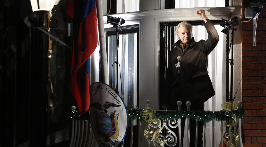 WikiLeaks founder Julian Assange gestures from the balcony of Ecuador's Embassy  as he makes a speech, in central London © Luke MacGregor