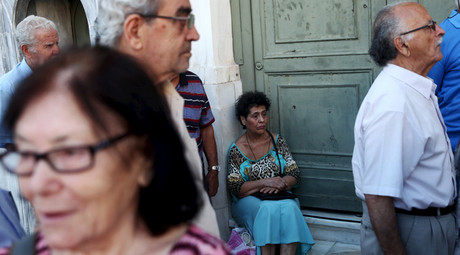 Pensioners wait to receive their pensions at a National Bank branch in Athens © Yiannis Kourtoglou