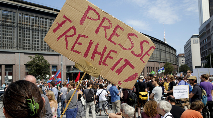 "A demonstrator holds up a placard which reads ""Freedom of press!""  in Berlin, Germany, August 1, 2015 © Fabrizio Bensch"